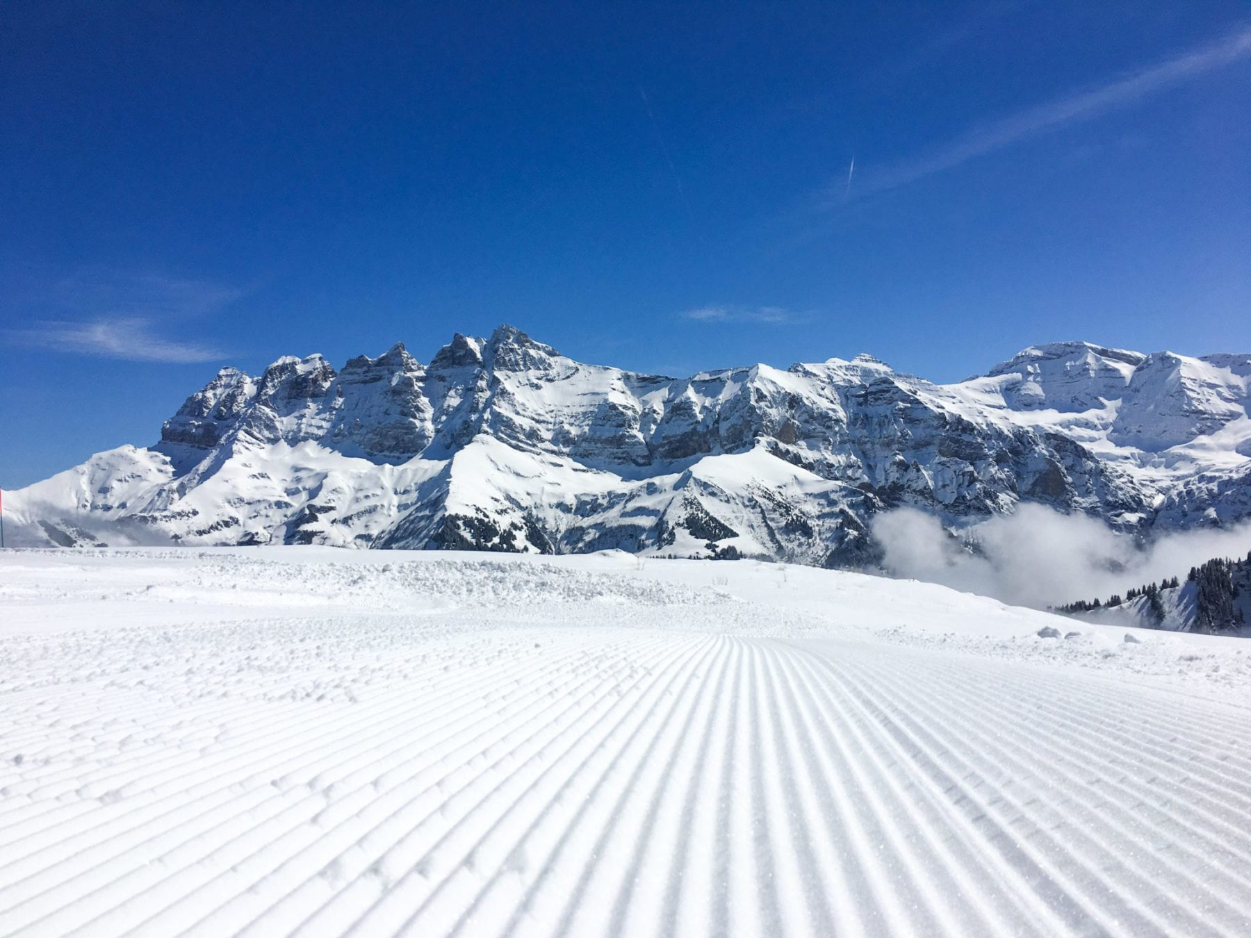 Fresh groomed snow with the Dents Du Midi in the background